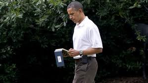 Obama reads his iPad while walking. ABC News.com