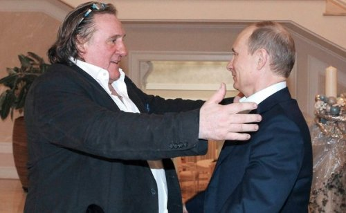 "(pool photo)GD embraces Putin, leader of his ""adoptive"" country -- or is he evaluating Putin as a possible hors d'oeuvre?"