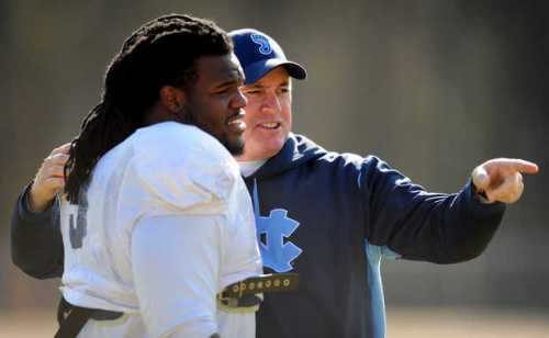 Former North Carolina head football coach Butch Davis talks with former defensive tackle Marvin Austin in a file photo. Austin is a key player in investigations involving improper contact with sports agents. JEFF SINER — JEFF SINER - jsiner@charlotteobserver.com