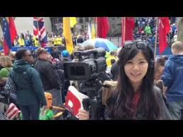 Boston University journalism student Kiva Liu, working near the finish line of the Boston Marathon, moments before two bombs exploded.