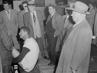 Ted Williams surrounded by the gentlemen of the press.  (via Boston Globe)