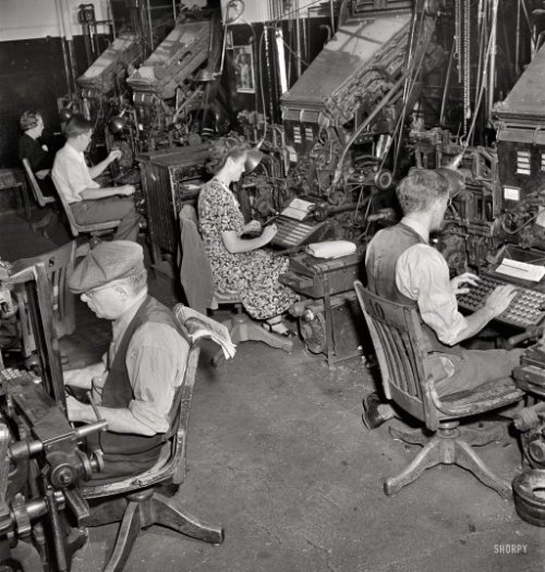 "September 1942. ""Linotype operators in composing room of the New York Times newspaper."" These machines cast lines of type (Linotype) from molten lead prior to their assembly by compositors into the printing plates that go on the presses. Photo by Marjory Collins for the Office of War Information."