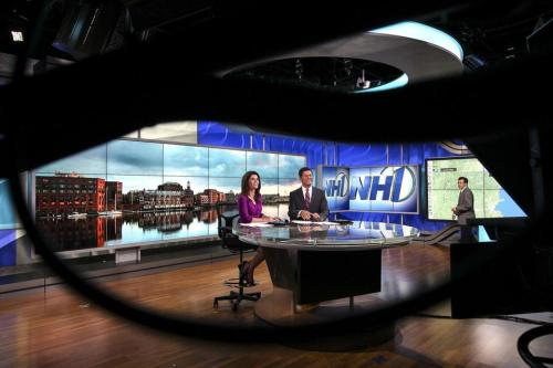 Shiny! The Globe caption says: NH1 News anchor KeKe Vencill (left), reporter/anchor Paul Mueller (center), and chief meteorologist Clayton Stiver rehearsed a news broadcast. Photo by Boston Globe