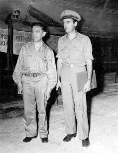 William Laurence (left) on Tinian Island before departing for Nagasaki.  Military photo.